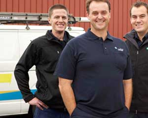 three of our Carmichael plumbers standing ready by their truck